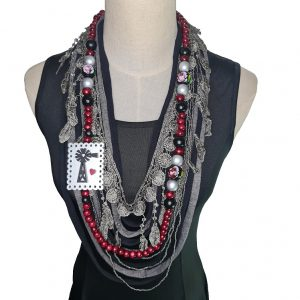 Black, silver, and Cherry red Tshirt scarf with a windmill pendant and lace