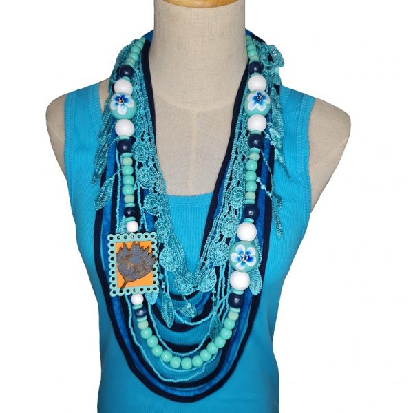 Blue and White Tshirt scarf with a protea pendant and lace